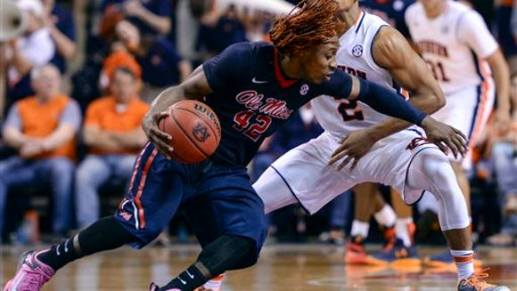 Mississippi guard Stefan Moody (42) drives past Auburn