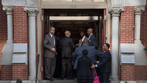 Attendees arrive at Metropolitan A.M.E. Church for the memorial service for journalist Gwen Ifill in Washington, Saturday, Nov. 19, 2016.