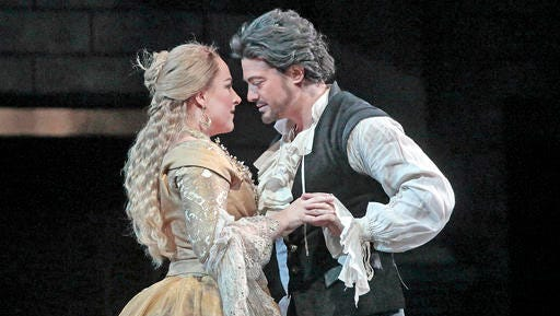 """This image released by the Metropolitan Opera shows German soprano Diana Damrau, left, and tenor Vittorio Grigolo in Gounod's """"Romeo et Juliette,"""" at the Metropolitan Opera in New York."""