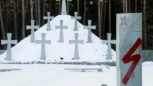 A Nazi symbol is seen painted on a memorial stone at a cemetery where Poles are buried in Bykivnia near the capital Kiev, Ukraine, Wednesday, Jan. 25, 2017. The inscription reads SS Galitchina, a reference to the Galicia division of Nazi SS organization made up mostly of ethnic Ukrainian volunteers during WW II. Ukrainian Foreign Minister Pavlo Klimkin denounced the vandals' action and said they will be punished.