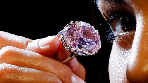 The Pink Star diamond, the most valuable cut diamond ever offered at auction is displayed by a model at Sotheby's auction rooms in London, Monday, March 20, 2017. It is the largest internally flawless fancy vivid pink diamond ever graded by the GIA. The diamond estimated in excess of 60 million US Dollars will go for auction in Hong Kong on April 4.