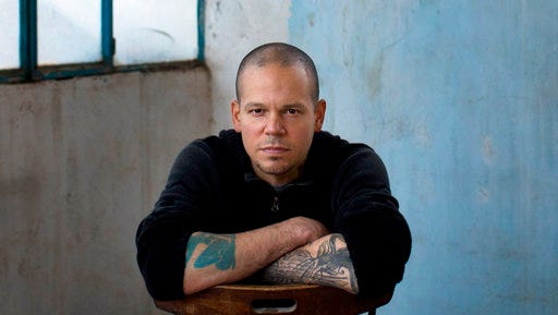 FILE - In this Dec. 5, 2013 file photo, Rene Perez Joglar, also known as Residente, of the musical group Calle 13, poses for a portrait in the West Bank town of Beit Shaour, near Bethlehem. Residente's self-titled album will be released on Friday, March 31, 2017.