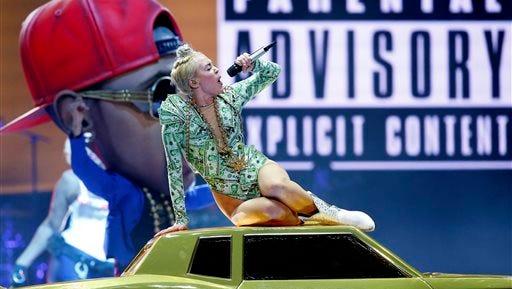 Miley Cyrus performs in concert at Bridgestone Arena on Thursday in Nashville, Tenn.