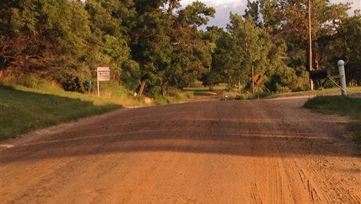 Police say a man was fatally attacked by dogs on this stretch of road.