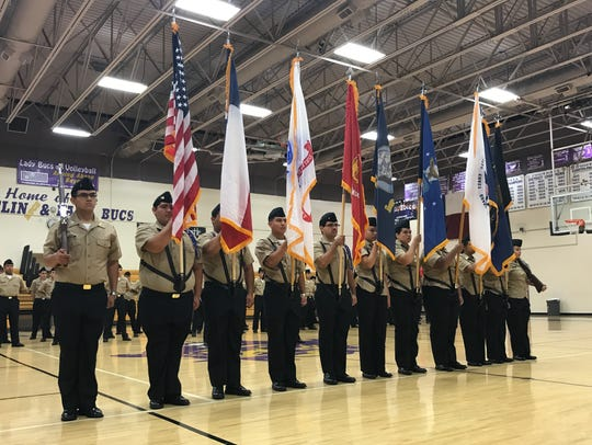 Students from Miller High School's ROTC program present the colors during the Veterans Day Ceremony on Friday.