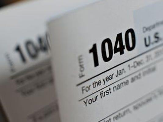636228469466032371-tax-form.jpg