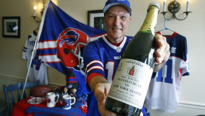 "Bills fan Pierre HŽeroux will open this ""New York champagne"" when the Bills win the Super Bowl."