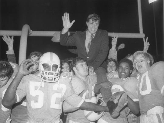 In this Dec. 20, 1970, photo provided by the University of Tennessee, former Tennessee football star Jackie Walker, left, celebrates a 14-13 win over Arkansas in the Liberty Bowl in Memphis, Tenn., with teammates. At center is current Tennessee coach Phillip Fulmer, hoisting then coach Bill Battle on his shoulder. Walker was the Southeastern Conference's first black All-American but has received little recognition for his accomplishments. (AP Photo/UT Sports Information)
