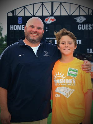 Plymouth assistant football coach Brian Rochon (left) and Connor Sherman are teaming up again to host the fourth annual Sunshines football clinic.