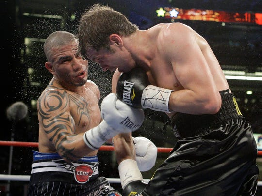 FILE - In this June 5, 2010, file photo, Miguel Cotto, of Puerto Rico, lands a right on Yuri Foreman during the sixth round of a WBA light middleweight title at Yankee Stadium in New York. Cotto is a boxing icon in Puerto Rico. In New York City, too. On Saturday night the most popular boxer of his generation from the Caribbean island that has produced so many champions will finish off his terrific career at Madison Square Garden with a title fight. AP Photo/Frank Franklin II,  File)