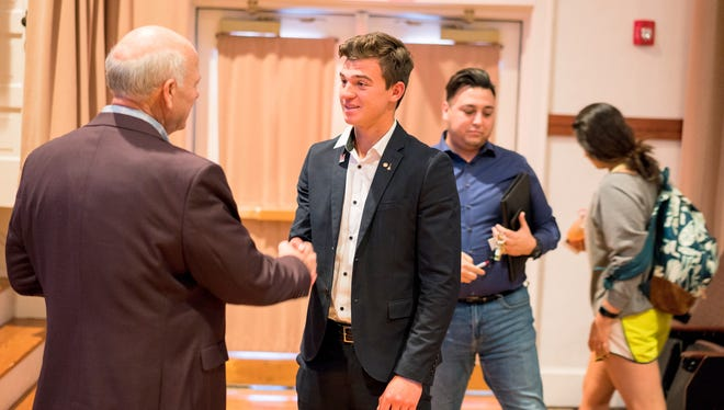 Western New Mexico University student and Delta Mu Delta International Business Honor Society President Vladimir Gnilozubov discusses business in New Mexico with Congressman Steve Pearce.