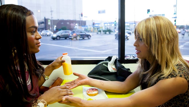 """Mya Taylor and Kitana Kiki Rodriguez talk inside Donut Time in """"Tangerine,"""" a Magnolia Pictures release."""