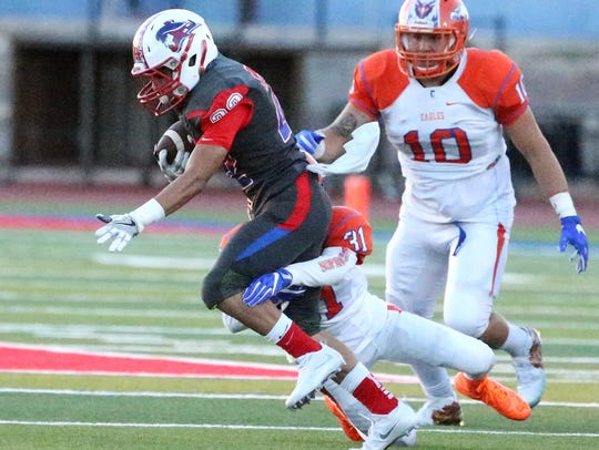 Bel Air tailback Andrew Chaffiino keeps the ball before