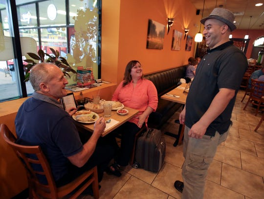 Elias Rhanim, co-owner of the Olive Tree Cafe, checks