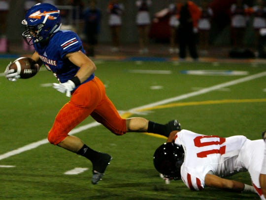 Westlake High running back Jason Heller (left) just gets caught from behind by Grace Brethren cornerback Hector Maradiaga during Friday night's game.