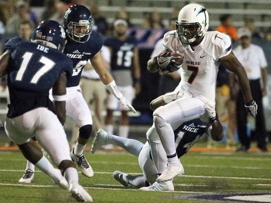 UTEP wide receiver Kavika Johnson, 7, is closed in