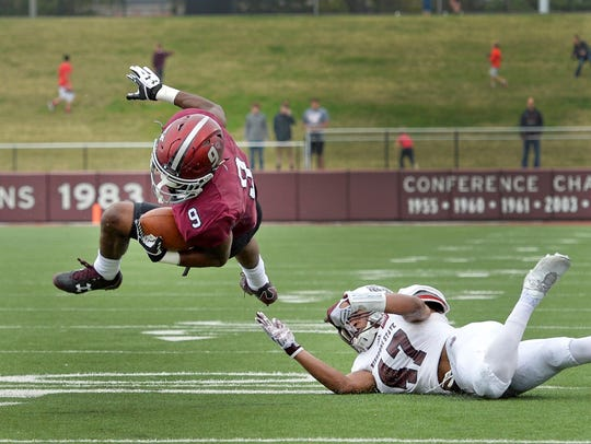 SIU running back D.J. Davis (9) is tripped up by Missouri