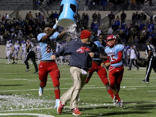 Hirschi head coach Danny Youngs tries to runs from Amiri Campbell after the Huskies win over Decatur Friday, Dec. 1, 2017, at C.H. Collins Athletic Complex in Denton.