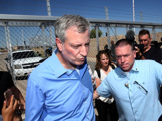 New York City Mayor Bill de Blasio speaks to media in front of the exit gate to the Marcelino Serna Port of Entry East El Paso Thursday. He and other members of the U.S, Conference of Mayors held a press conference there to protest the separation of undocumented immigrant children from their parents and demand the reunification of families as soon possible. Some of the children are housed at the port of entry.