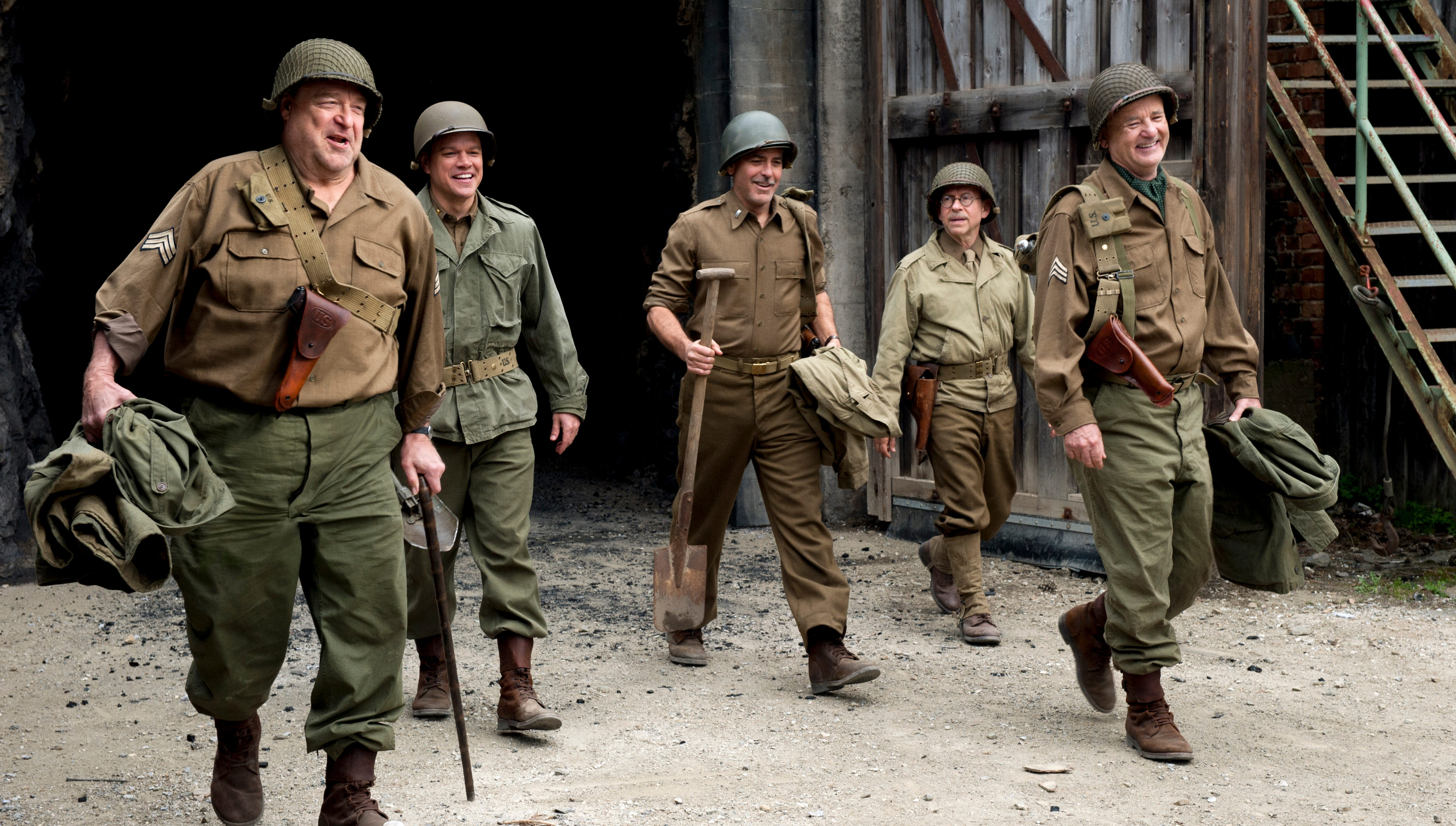 "John Goodman, left, Matt Damon, George Clooney, Bob Balaban and Bill Murray in a scene from 'The Monuments Men.' Though the film is about stolen art,  ""I don't own any art except paintings from my godkids,"" Clooney says. ""Which I'm convinced are priceless."""