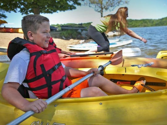 Carson Rockwell took a kayak out for the first time Wednesday, June 8, 2016, at Eagle Creek Park.