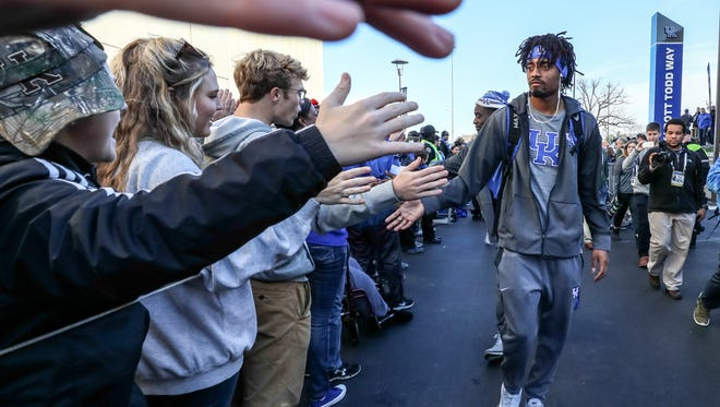 UK quarterback Stephen Johnson is greeted by fans as he arrives at Kroger Field before the game with Louisville.November 25, 2017