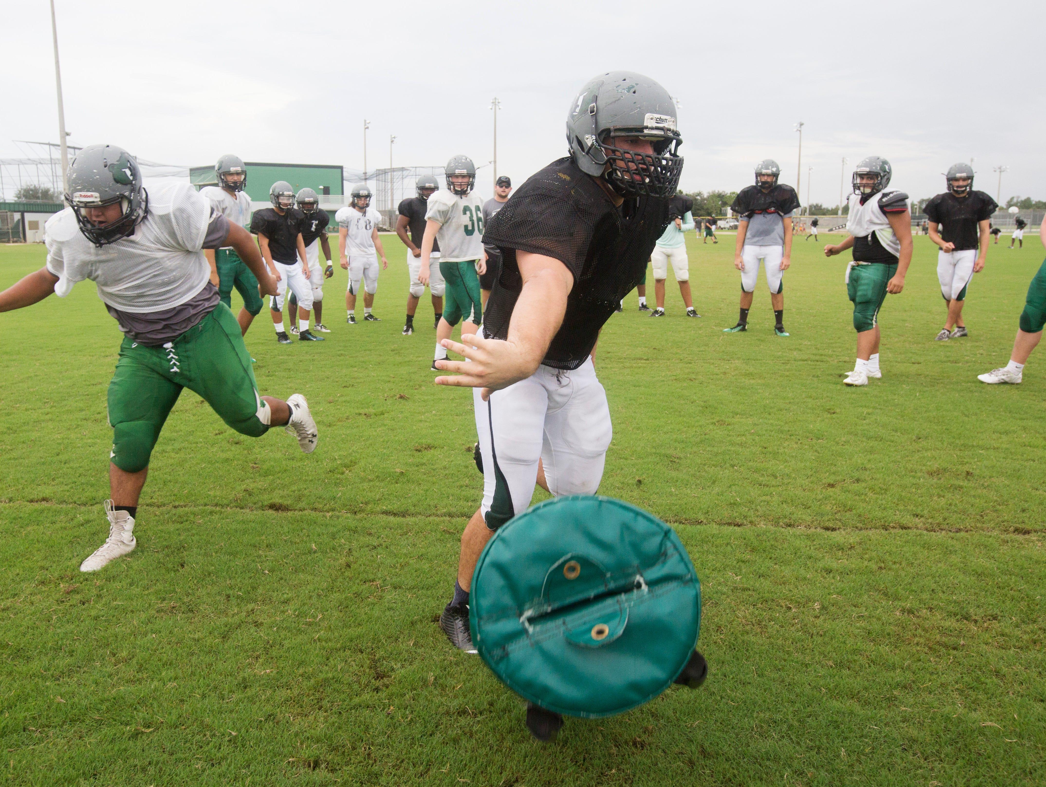 Plmetto Ridge High School defensive lineman Joe Chmielowsk runs drills during practice Tuesday.
