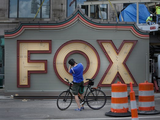 A bicyclist stops to take a photo of the new Fox Theater