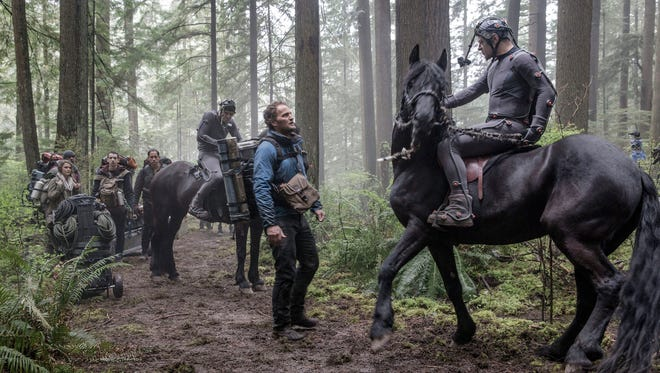 """Andy Serkis (right) on horseback performs in his motion-capture gear while filming """"Dawn of the Planet of the Apes."""""""