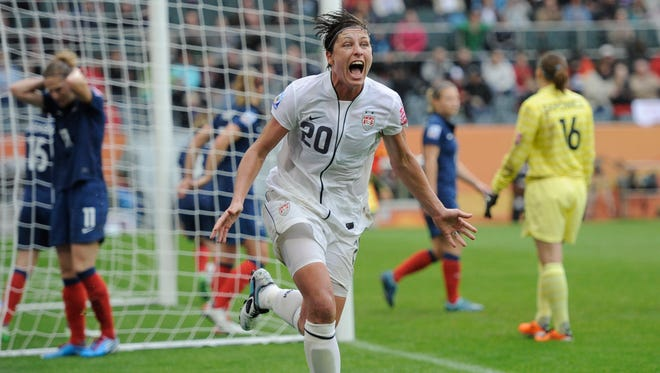 In this July 13, 2011, file photo, United States' Abby Wambach celebrates scoring her side's second goal during a semifinal match against France at the Women's Soccer World Cup in Moenchengladbach, Germany.