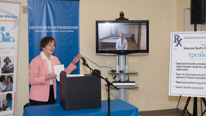 Neighborhood Health CEO Mary Bufwack leads a demonstration of telehealth technology with psychiatric nurse practitioner Brian Glass at a Neighborhood Health clinic in East Nashville on Thursday. The consult is one way that technology can link people in low-income communities to behavioral health and nutrition experts to fight chronic diseases such as diabetes, obesity and depression.