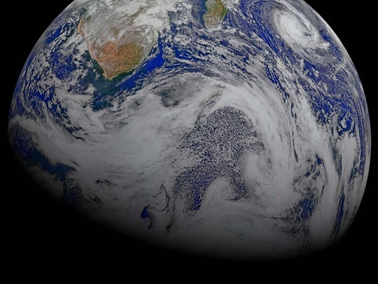 This image provided by NASA Data from six orbits of the Suomi-NPP spacecraft on April 9, 2015 have been assembled into this perspective composite of southern Africa and the surrounding oceans.