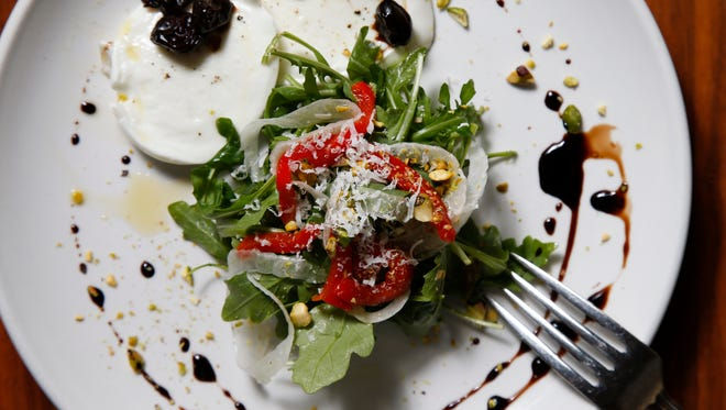 The buffalo mozzarella salad with arugula, roasted red pepper, fennel and tart cherry balsamic
