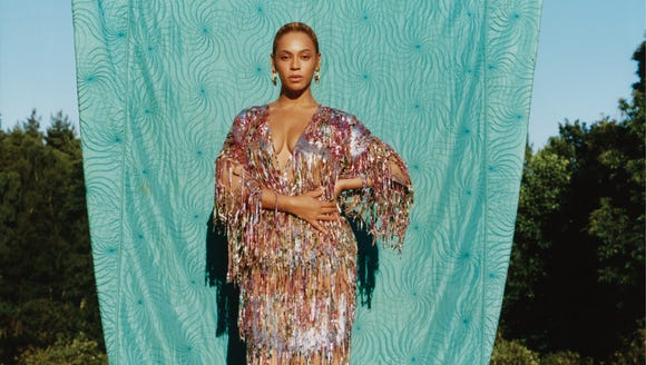 Bey headed outdoors to pose in this Gucci dress.