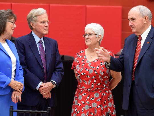 Pat Lingle, left, and Paul Lingle talk with IUE Chancellor Kathryn Cruz-Uribe and IU President Michael McRobbie Friday, Aug. 19, 2016, inside the new Indiana University East Student Events and Activities Center in Richmond.The court bears the Lingle name.