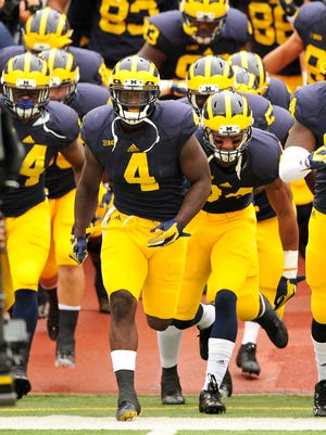 De'Veon Smith and the Wolverines will practice in Ford Field on Saturday.