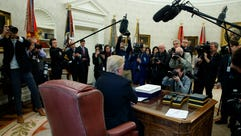 President Trump speaks to reporters in the Oval Office
