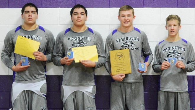 Yerington wrestlers winning Northern III/IV tourney titles last weekend are, from left, Santana Sanchez, Santino Sanchez, Reese Neville and Cade Draper. Neville also holds the sportsmanship plaque he won that is annually given by the wrestling officials association.