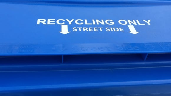 Instructions on the top of the city's new blue single-stream recycling containers.