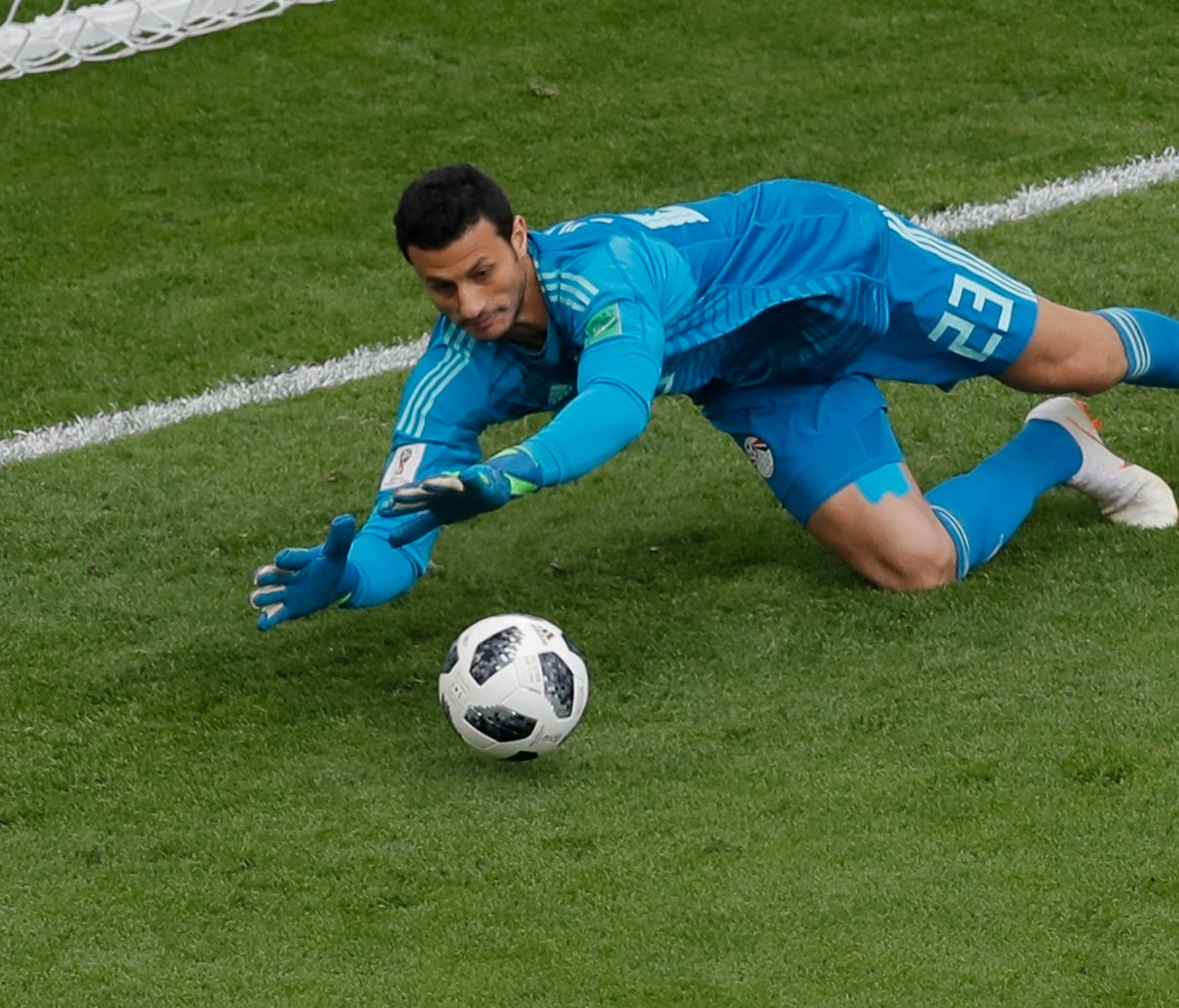 Egypt goalkeeper Mohamed El-Shenawy makes a stop against Uruguay.