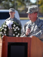Col. Scott Belanger addresses the crowd Thursday morning