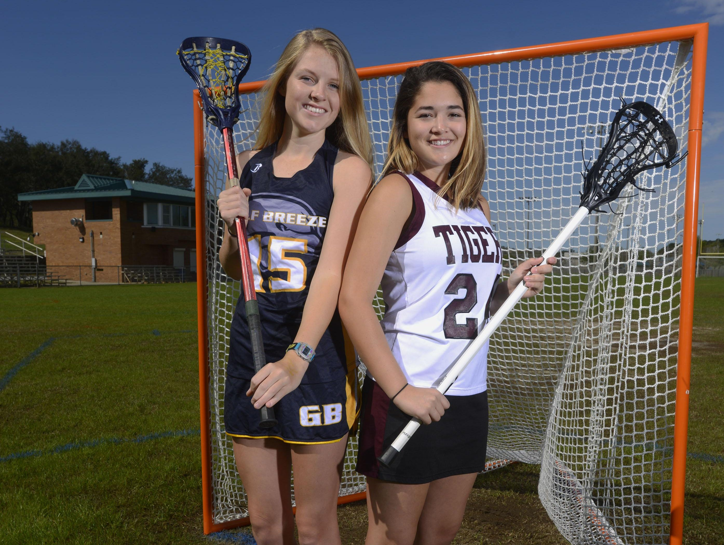Prep lacrosse stars and best friends Frances Williams, a senior at Gulf Breeze High and Victoria Warren, a junior at Pensacola High on the field at Shoreline Park where both girls learned the sport as middle school kids.