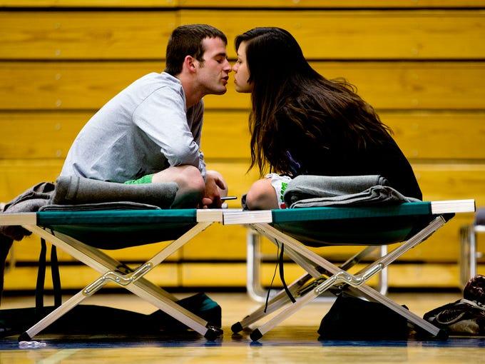 Nathan Westerfield, 22, kisses his new bride, Mickella,