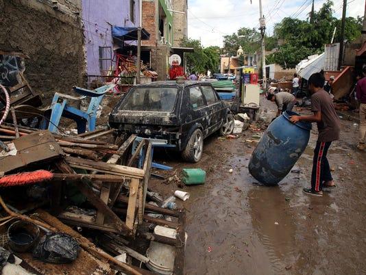 636644086706991318-Reparten-culpas-por-inundacion-334372.JPG