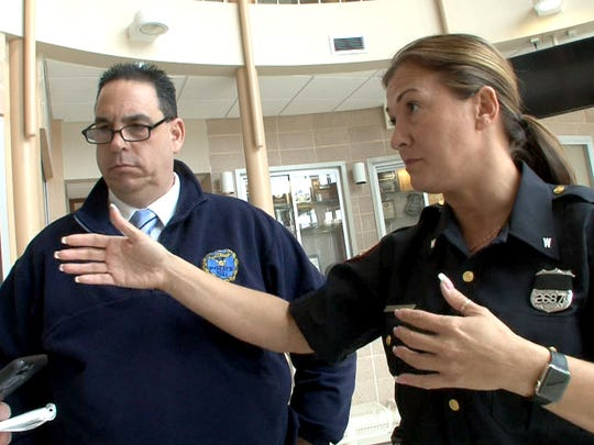 Donnamarie Viola-Disbrow  and Vinnie Disbrow, a husband and wife team of Jersey City police officers, describe the recsue they made on Easter Sunday of an elderly woman whose car flew into a retaining pond in Eatontown.   They are shown are shown at the department's West District Wednesday, April 19, 2017.