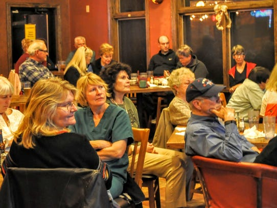 Crowds gathered Tuesday to watch election results on