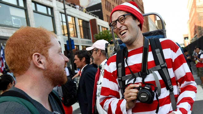 """""""It doesn't matter what your race, your creed, your background or religion is, people respond very well to Waldo,"""" said Justin Vetter of Pittsburgh. Vetter dressed like the children's book character while walking around Cleveland and meeting with people outside of the Republican National Convention held the Quicken Loans Arena on Tuesday, July 19, 2016."""