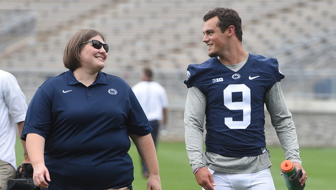Penn State QB, Trace McSorley, right and Kris Petersen, the Penn State Associate Director of Athletic Communications, walk off the field of Beaver Stadium after participating in Media Day in State College on Thursday, August 4, 2016.