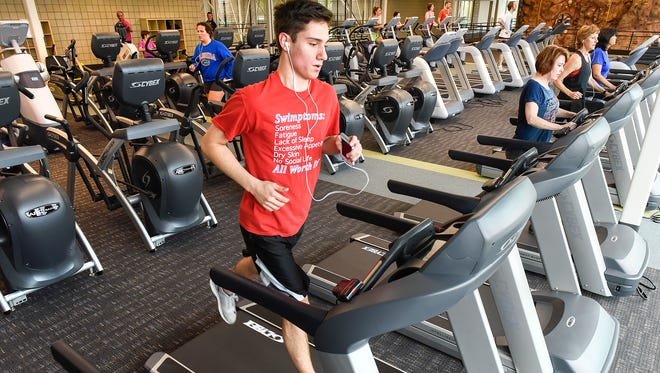 Andrew Gasperlan runs on a treadmill at the new St. Cloud YMCA Community and Aquatic Center Tuesday, May 30, on opening day.