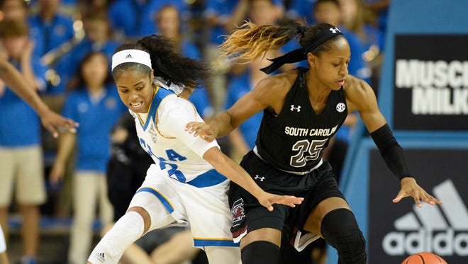 UCLA Bruins guard Jordin Canada attempts to steal the ball from South Carolina Gamecocks guard Tiffany Mitchell.